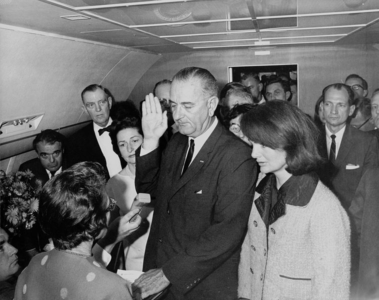 Lyndon B. Johnson taking the oath of office, November 1963. Cecil Stoughton.